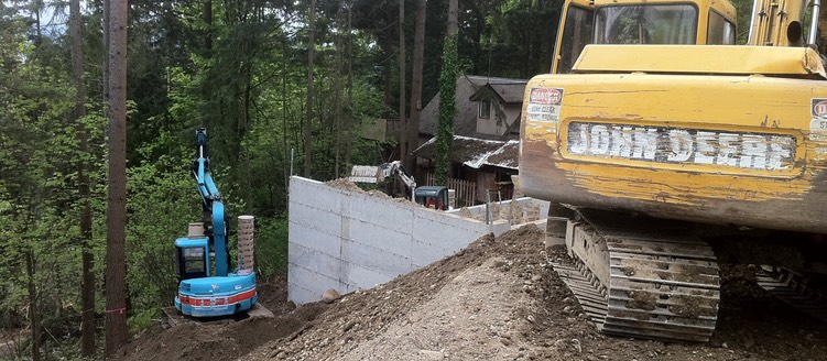 Backfilling around the outside of the foundation